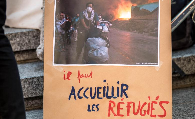 placard with a picture of Moria camp on fire at a protest in Lausanne, Switzerland, 12 September.