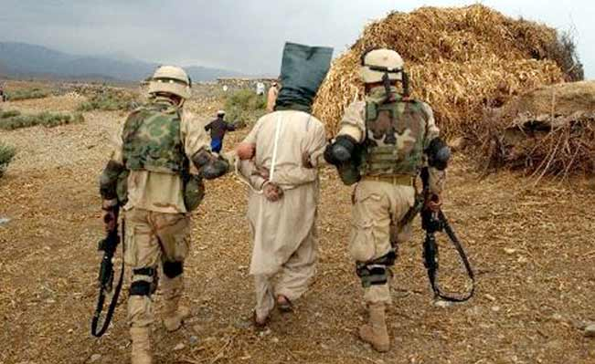 Afghan detainee led away by US troops
