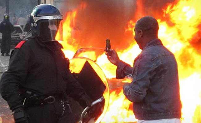 Rioter photographs police with mobile