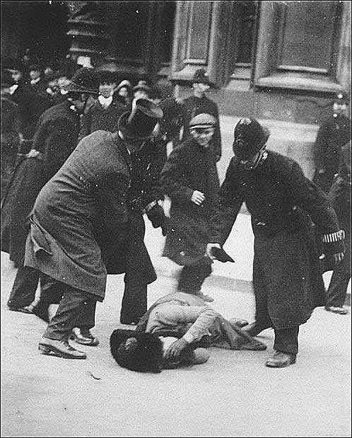 The photograph the government tried to hide. Suffragette Ada Wright collapses through police violence on Black Friday