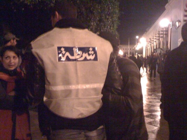 A friendly cop clearly on the wrong team in the Tunis Casbah Square occupation