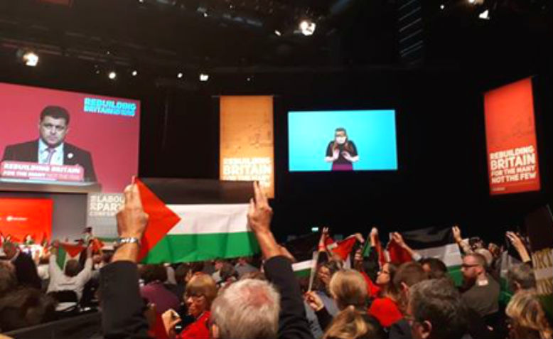 The labour conference during the speech by Colin Monehen of Harlow CLP, moving the motion recognising the 1948 Nakba in Palestine and calling for the suspension of arms sales to Israel, 25.9.18. Photo: James Thomas Griffiths.