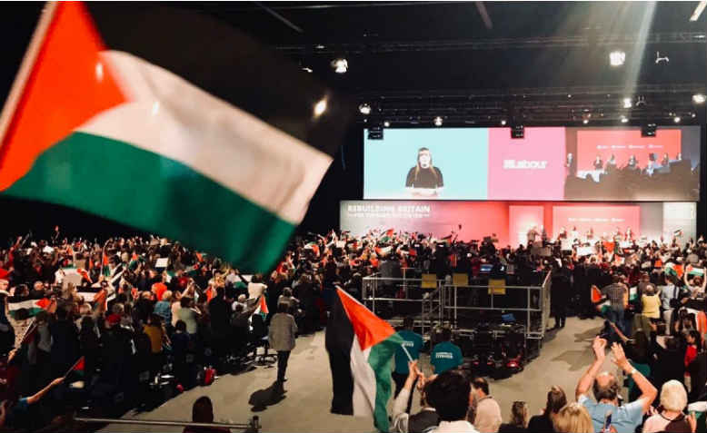 Labour Conference, delegates wave Palestinian flags. Photo: Palestine Solidarity Campaign