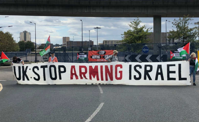 Stop DSEI protesters blocking the road in front of the ExCel centre. Photo: Shabbir Lakha