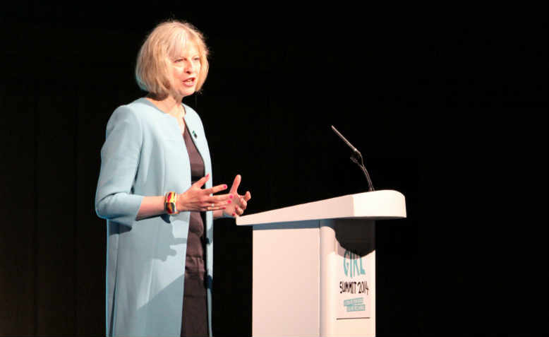 Theresa May speaking at the Girl Summit in 2014
