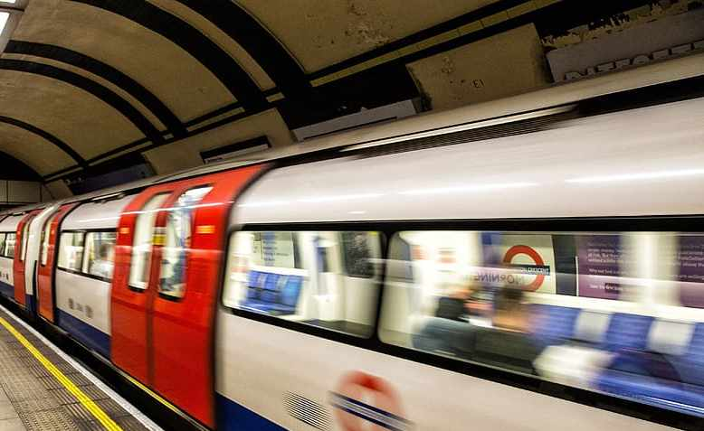 A tube train arrives at a platform on the London Underground,